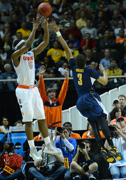 March 23, 2013: Syracuse Orange forward C.J. Fair (5) shoots over California Golden Bears guard Tyrone Wallace (3) during a game between the Syracuse Orange and the California Golden Bears in the third round of the NCAA Division I Men's Basketball Championship at HP Pavilion in San Jose, California.