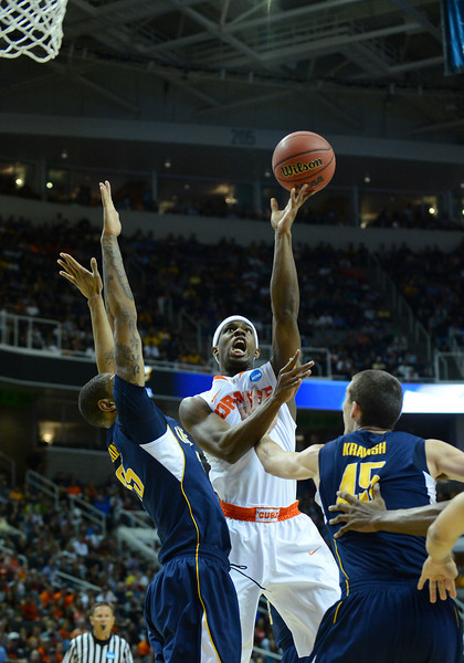 March 23, 2013: Syracuse Orange forward C.J. Fair (5) puts up a shot during a game between the Syracuse Orange and the California Golden Bears in the third round of the NCAA Division I Men's Basketball Championship at HP Pavilion in San Jose, California.
