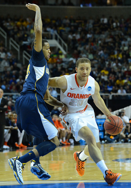 March 23, 2013: Syracuse Orange guard Brandon Triche (20) drives to the basket during a game between the Syracuse Orange and the California Golden Bears in the third round of the NCAA Division I Men's Basketball Championship at HP Pavilion in San Jose, California.
