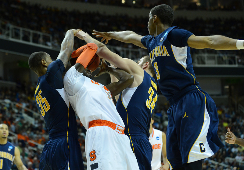 March 23, 2013: A Syracuse Orange player battles for a rebound during a game between the Syracuse Orange and the California Golden Bears in the third round of the NCAA Division I Men's Basketball Championship at HP Pavilion in San Jose, California.