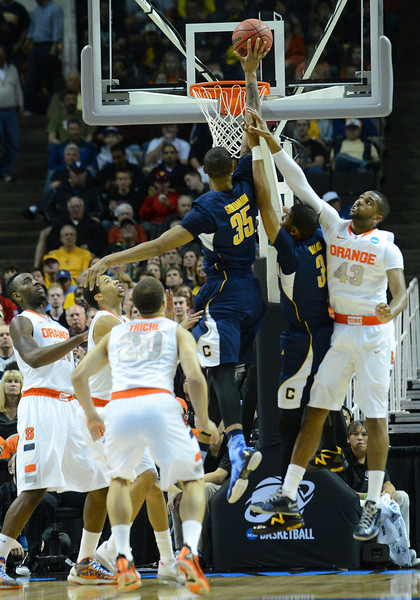 March 23, 2013: California Golden Bears forward Richard Solomon (35) puts up a shot near the rim during a game between the Syracuse Orange and the California Golden Bears in the third round of the NCAA Division I Men's Basketball Championship at HP Pavilion in San Jose, California.