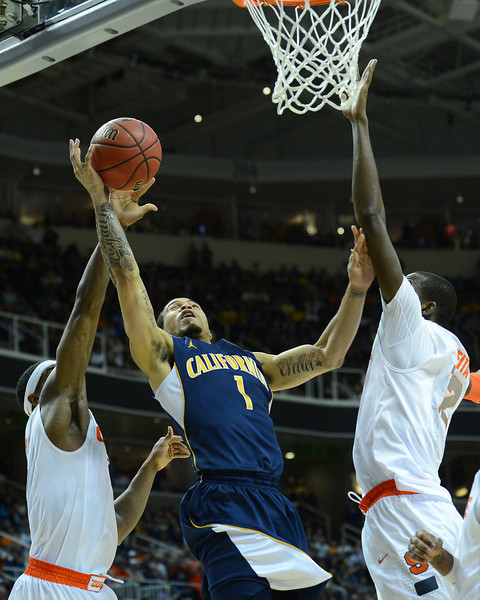 March 23, 2013: California Golden Bears guard Justin Cobbs (1) drives to the basket during a game between the Syracuse Orange and the California Golden Bears in the third round of the NCAA Division I Men's Basketball Championship at HP Pavilion in San Jose, California.