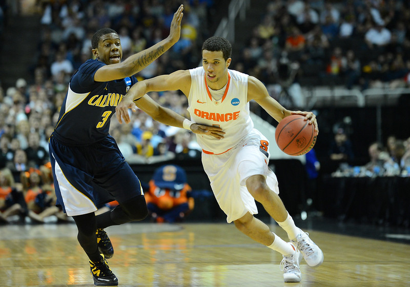 March 23, 2013: Syracuse Orange guard Michael Carter-Williams (1) drives past California Golden Bears guard Tyrone Wallace (3) during a game between the Syracuse Orange and the California Golden Bears in the third round of the NCAA Division I Men's Basketball Championship at HP Pavilion in San Jose, California.