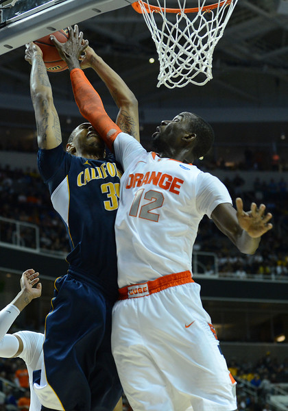 March 23, 2013: Syracuse Orange center Baye Keita (12) blocks the shot of California Golden Bears forward Richard Solomon (35) during a game between the Syracuse Orange and the California Golden Bears in the third round of the NCAA Division I Men's Basketball Championship at HP Pavilion in San Jose, California.