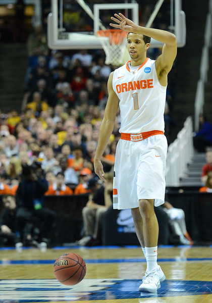 March 23, 2013: Syracuse Orange guard Michael Carter-Williams (1) calls out a play during a game between the Syracuse Orange and the California Golden Bears in the third round of the NCAA Division I Men's Basketball Championship at HP Pavilion in San Jose, California.