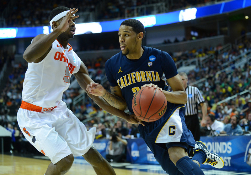 March 23, 2013: California Golden Bears guard Allen Crabbe (23) drives past Syracuse Orange forward C.J. Fair (5) during a game between the Syracuse Orange and the California Golden Bears in the third round of the NCAA Division I Men's Basketball Championship at HP Pavilion in San Jose, California.