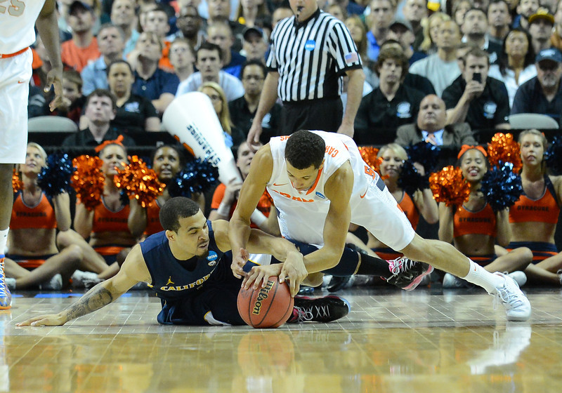 March 23, 2013: California Golden Bears guard Justin Cobbs (1) and Syracuse Orange guard Michael Carter-Williams (1) battle for a loose ball during a game between the Syracuse Orange and the California Golden Bears in the third round of the NCAA Division I Men's Basketball Championship at HP Pavilion in San Jose, California.