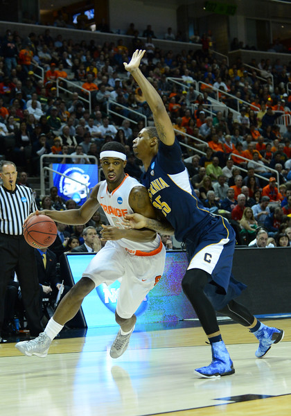 March 23, 2013: Syracuse Orange forward C.J. Fair (5) drives to the basket during a game between the Syracuse Orange and the California Golden Bears in the third round of the NCAA Division I Men's Basketball Championship at HP Pavilion in San Jose, California.