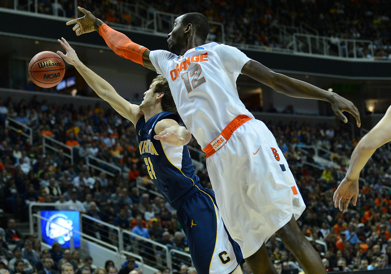 March 23, 2013: California Golden Bears guard Ricky Kreklow (24) and Syracuse Orange center Baye Keita (12) battle for a rebound during a game between the Syracuse Orange and the California Golden Bears in the third round of the NCAA Division I Men's Basketball Championship at HP Pavilion in San Jose, California.