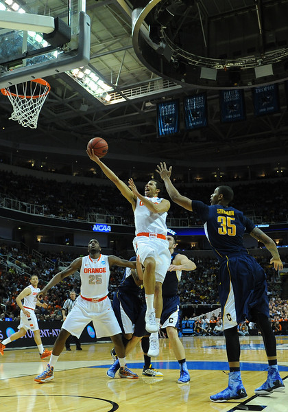 March 23, 2013: Syracuse Orange guard Michael Carter-Williams (1) goes in for a layup during a game between the Syracuse Orange and the California Golden Bears in the third round of the NCAA Division I Men's Basketball Championship at HP Pavilion in San Jose, California.