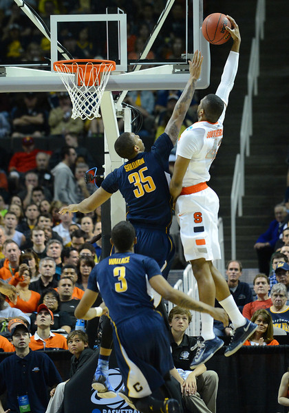 March 23, 2013: Syracuse Orange forward James Southerland (43) goes up for a dunk attempt over California Golden Bears forward Richard Solomon (35) during a game between the Syracuse Orange and the California Golden Bears in the third round of the NCAA Division I Men's Basketball Championship at HP Pavilion in San Jose, California.