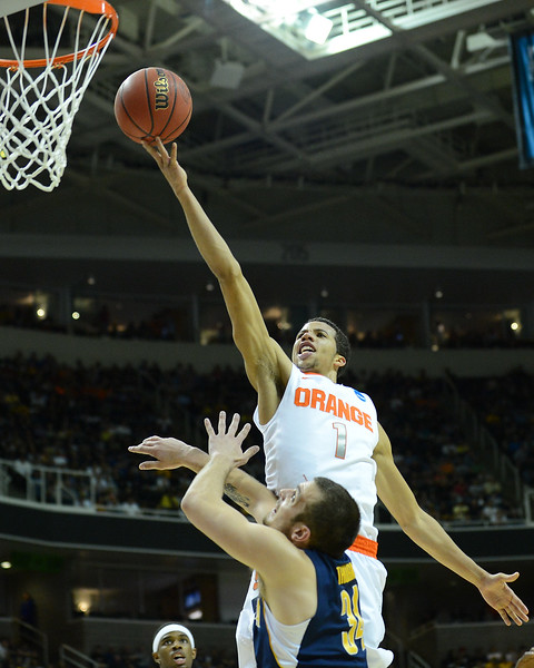 March 23, 2013: Syracuse Orange guard Michael Carter-Williams (1) gets a layup during a game between the Syracuse Orange and the California Golden Bears in the third round of the NCAA Division I Men's Basketball Championship at HP Pavilion in San Jose, California.
