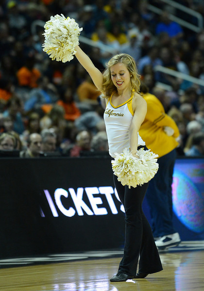 March 23, 2013: A California Golden Bears cheerleader performs in a timeout during a game between the Syracuse Orange and the California Golden Bears in the third round of the NCAA Division I Men's Basketball Championship at HP Pavilion in San Jose, California.