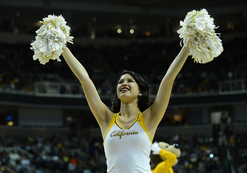 March 23, 2013: A California Golden Bears cheerleader performs during a game between the Syracuse Orange and the California Golden Bears in the third round of the NCAA Division I Men's Basketball Championship at HP Pavilion in San Jose, California.