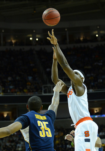 March 23, 2013: Syracuse Orange forward C.J. Fair (5) takes a shot over California Golden Bears forward Richard Solomon (35) during a game between the Syracuse Orange and the California Golden Bears in the third round of the NCAA Division I Men's Basketball Championship at HP Pavilion in San Jose, California.