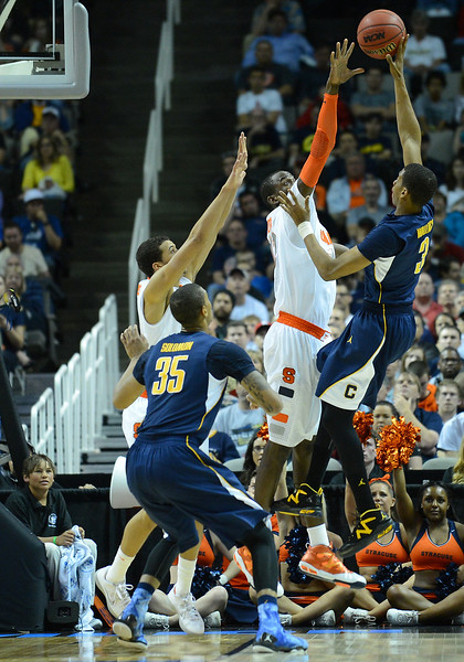March 23, 2013: California Golden Bears guard Tyrone Wallace (3) puts up a shot during a game between the Syracuse Orange and the California Golden Bears in the third round of the NCAA Division I Men's Basketball Championship at HP Pavilion in San Jose, California.