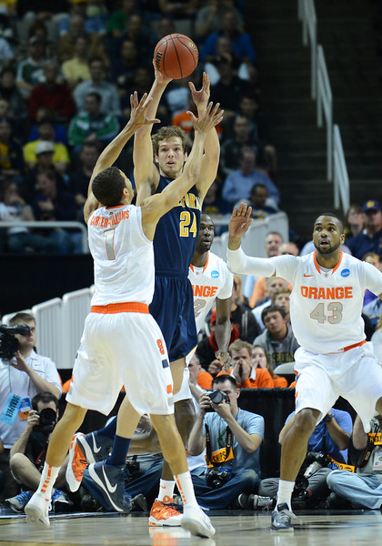 March 23, 2013: California Golden Bears guard Ricky Kreklow (24) passes the ball over the defense during a game between the Syracuse Orange and the California Golden Bears in the third round of the NCAA Division I Men's Basketball Championship at HP Pavilion in San Jose, California.