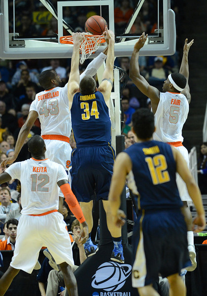 March 23, 2013: California Golden Bears forward Robert Thurman (34) tries to dunk during a game between the Syracuse Orange and the California Golden Bears in the third round of the NCAA Division I Men's Basketball Championship at HP Pavilion in San Jose, California.