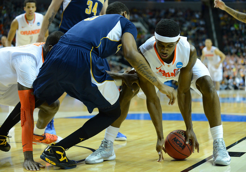 March 23, 2013: Syracuse Orange forward C.J. Fair (5) grabs a loose ball during a game between the Syracuse Orange and the California Golden Bears in the third round of the NCAA Division I Men's Basketball Championship at HP Pavilion in San Jose, California.