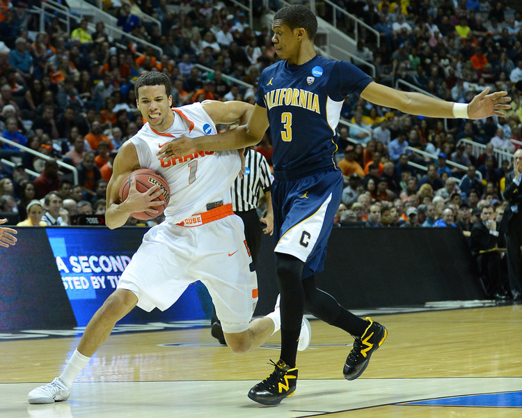 March 23, 2013: Syracuse Orange guard Michael Carter-Williams (1) tries to drive past California Golden Bears guard Tyrone Wallace (3) during a game between the Syracuse Orange and the California Golden Bears in the third round of the NCAA Division I Men's Basketball Championship at HP Pavilion in San Jose, California.