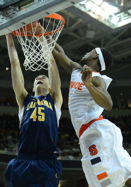 March 23, 2013: Syracuse Orange forward C.J. Fair (5) blocks a dunk attempt by California Golden Bears forward David Kravish (45) during a game between the Syracuse Orange and the California Golden Bears in the third round of the NCAA Division I Men's Basketball Championship at HP Pavilion in San Jose, California.