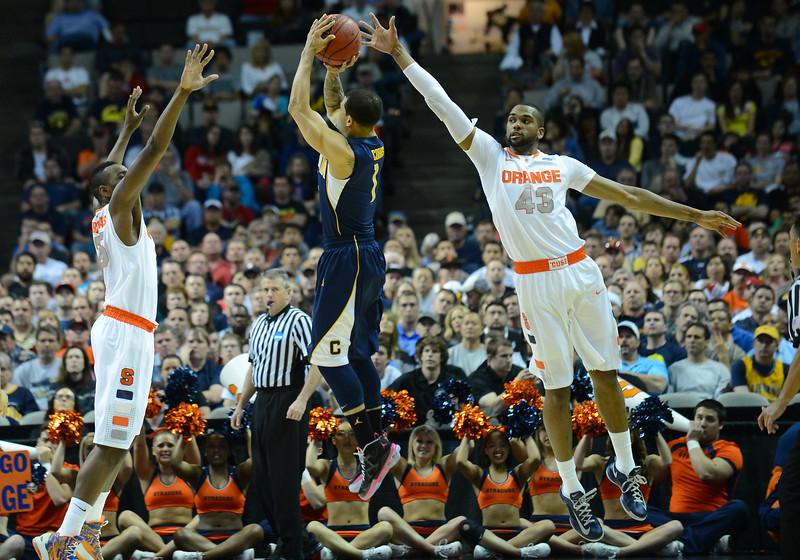 March 23, 2013: California Golden Bears guard Justin Cobbs (1) shoots a three point shot during a game between the Syracuse Orange and the California Golden Bears in the third round of the NCAA Division I Men's Basketball Championship at HP Pavilion in San Jose, California.