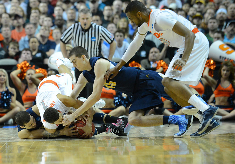 March 23, 2013: Syracuse Orange and California Golden Bears players battle for a loose ball during a game between the Syracuse Orange and the California Golden Bears in the third round of the NCAA Division I Men's Basketball Championship at HP Pavilion in San Jose, California.