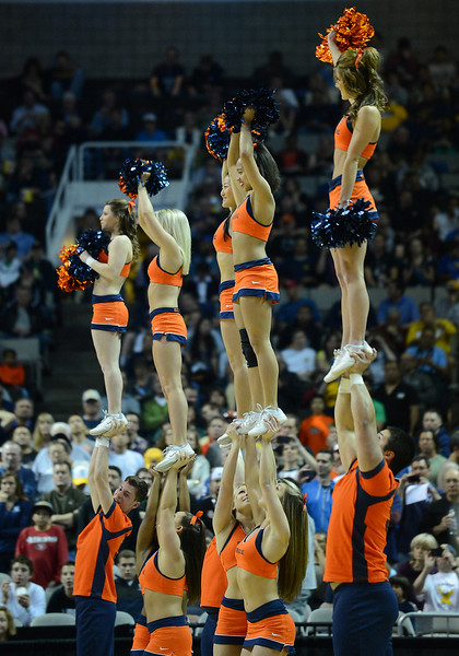 March 23, 2013: Syracuse Orange cheerleaders perform during a game between the Syracuse Orange and the California Golden Bears in the third round of the NCAA Division I Men's Basketball Championship at HP Pavilion in San Jose, California.
