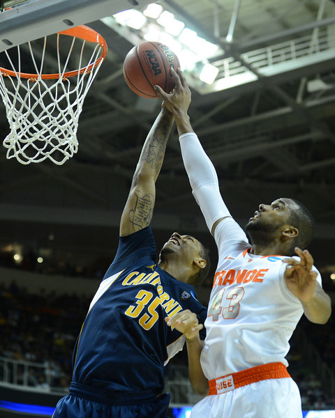 March 23, 2013: California Golden Bears forward Richard Solomon (35) has his shot blocked by Syracuse Orange forward James Southerland (43) during a game between the Syracuse Orange and the California Golden Bears in the third round of the NCAA Division I Men's Basketball Championship at HP Pavilion in San Jose, California.