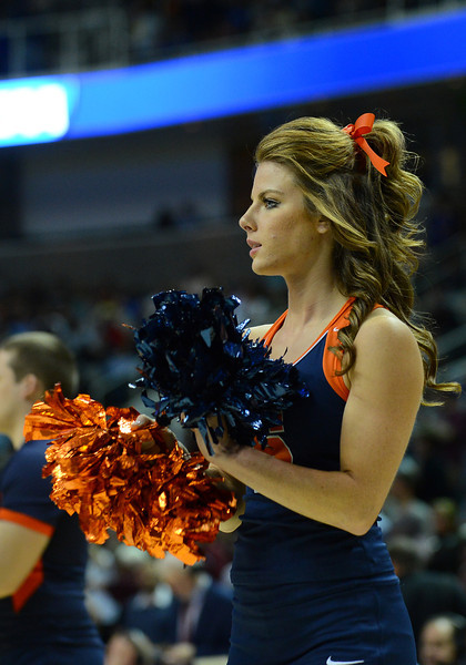 March 21, 2013: A Syracuse Orange cheerleader cheers during the announcement of the starting lineups during a game between the Syracuse Orangemen and the Montana Grizzlies in the second round of the NCAA Division I Men's Basketball Championship at HP Pavilion in San Jose, California.