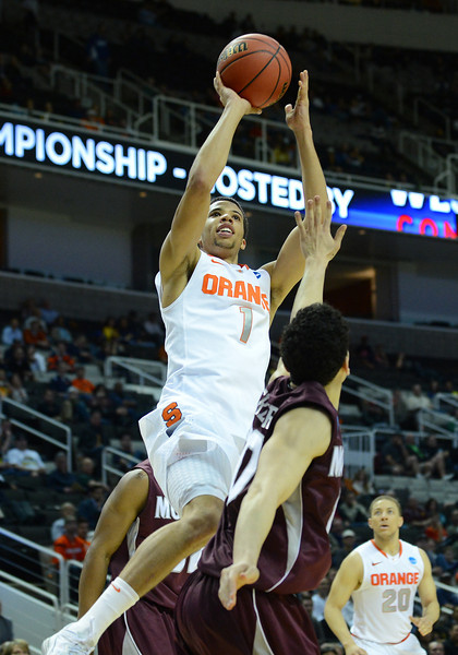 March 21, 2013: Syracuse Orange guard Michael Carter-Williams (1) puts up a shot during a game between the Syracuse Orangemen and the Montana Grizzlies in the second round of the NCAA Division I Men's Basketball Championship at HP Pavilion in San Jose, California.