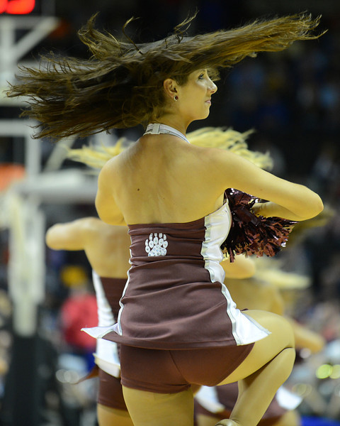 March 21, 2013: A Montana Grizzlies cheerleader performs in a timeout during a game between the Syracuse Orangemen and the Montana Grizzlies in the second round of the NCAA Division I Men's Basketball Championship at HP Pavilion in San Jose, California.