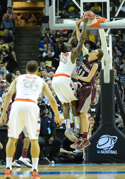 March 21, 2013: Syracuse Orange forward Rakeem Christmas (25) dunks over Montana Grizzlies center Andy Martin (41) during a game between the Syracuse Orangemen and the Montana Grizzlies in the second round of the NCAA Division I Men's Basketball Championship at HP Pavilion in San Jose, California.