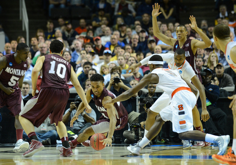 March 21, 2013: Montana Grizzlies and Syracuse Orange players scramble for a loose ball during a game between the Syracuse Orangemen and the Montana Grizzlies in the second round of the NCAA Division I Men's Basketball Championship at HP Pavilion in San Jose, California.