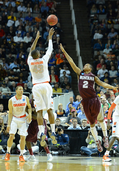 March 21, 2013: Syracuse Orange forward James Southerland (43) shoots a three pointer over Montana Grizzlies guard/forward Kevin Henderson (2) during a game between the Syracuse Orangemen and the Montana Grizzlies in the second round of the NCAA Division I Men's Basketball Championship at HP Pavilion in San Jose, California.