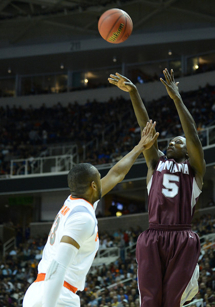 March 21, 2013: Montana Grizzlies guard Will Cherry (5) shoots over a Syracuse Orange defender during a game between the Syracuse Orangemen and the Montana Grizzlies in the second round of the NCAA Division I Men's Basketball Championship at HP Pavilion in San Jose, California.