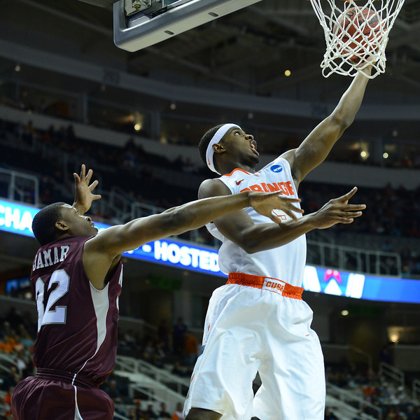 March 21, 2013: Syracuse Orange forward C.J. Fair (5) gets a layup during a game between the Syracuse Orangemen and the Montana Grizzlies in the second round of the NCAA Division I Men's Basketball Championship at HP Pavilion in San Jose, California.