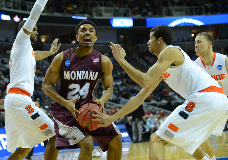 March 21, 2013: Montana Grizzlies forward Spencer Coleman (24) has the ball stripped during a game between the Syracuse Orangemen and the Montana Grizzlies in the second round of the NCAA Division I Men's Basketball Championship at HP Pavilion in San Jose, California.