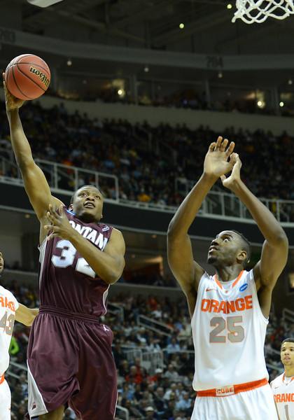 March 21, 2013: Montana Grizzlies guard/forward Kareem Jamar (32) puts up a layup during a game between the Syracuse Orangemen and the Montana Grizzlies in the second round of the NCAA Division I Men's Basketball Championship at HP Pavilion in San Jose, California.
