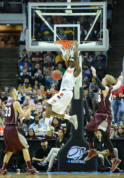 March 21, 2013: Syracuse Orange forward C.J. Fair (5) dunks during a game between the Syracuse Orangemen and the Montana Grizzlies in the second round of the NCAA Division I Men's Basketball Championship at HP Pavilion in San Jose, California.