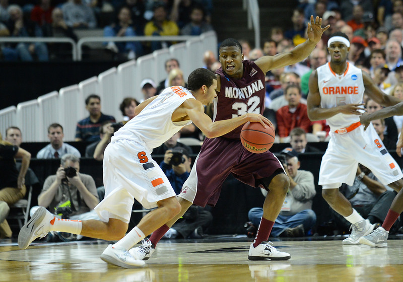 March 21, 2013: Syracuse Orange guard Michael Carter-Williams (1) drives past Montana Grizzlies guard/forward Kareem Jamar (32) during a game between the Syracuse Orangemen and the Montana Grizzlies in the second round of the NCAA Division I Men's Basketball Championship at HP Pavilion in San Jose, California.