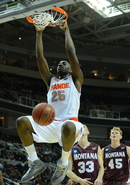 March 21, 2013: Syracuse Orange forward Rakeem Christmas (25) dunks during a game between the Syracuse Orangemen and the Montana Grizzlies in the second round of the NCAA Division I Men's Basketball Championship at HP Pavilion in San Jose, California.