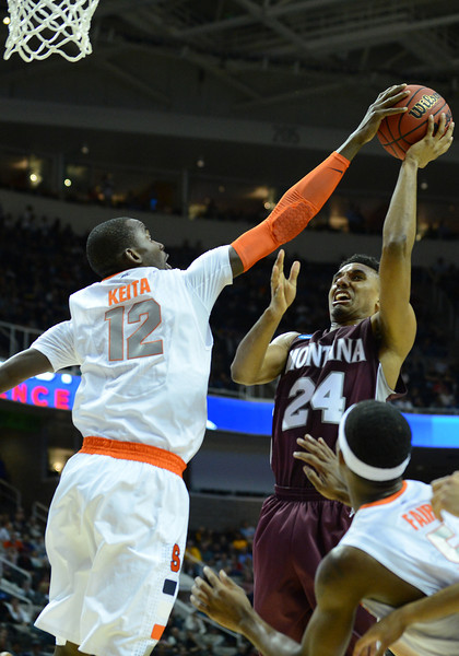 March 21, 2013: Syracuse Orange center Baye Keita (12) blocks a shot from Montana Grizzlies forward Spencer Coleman (24) during a game between the Syracuse Orangemen and the Montana Grizzlies in the second round of the NCAA Division I Men's Basketball Championship at HP Pavilion in San Jose, California.