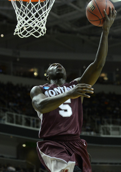 March 21, 2013: Montana Grizzlies guard Will Cherry (5) puts up a layup during a game between the Syracuse Orangemen and the Montana Grizzlies in the second round of the NCAA Division I Men's Basketball Championship at HP Pavilion in San Jose, California.