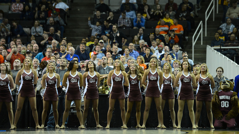 March 21, 2013: The Montana Grizzlies cheerleaders watch the jumbotron during a game between the Syracuse Orangemen and the Montana Grizzlies in the second round of the NCAA Division I Men's Basketball Championship at HP Pavilion in San Jose, California.