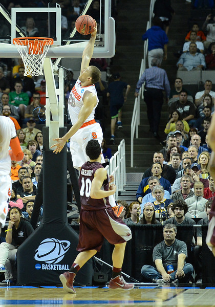 March 21, 2013: Syracuse Orange guard Brandon Triche (20) dunks during a game between the Syracuse Orangemen and the Montana Grizzlies in the second round of the NCAA Division I Men's Basketball Championship at HP Pavilion in San Jose, California.