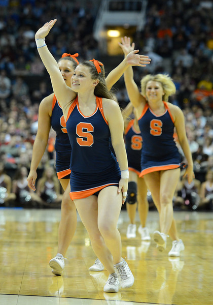 March 21, 2013: Syracuse Orange cheerleaders perform in a timeout during a game between the Syracuse Orangemen and the Montana Grizzlies in the second round of the NCAA Division I Men's Basketball Championship at HP Pavilion in San Jose, California.