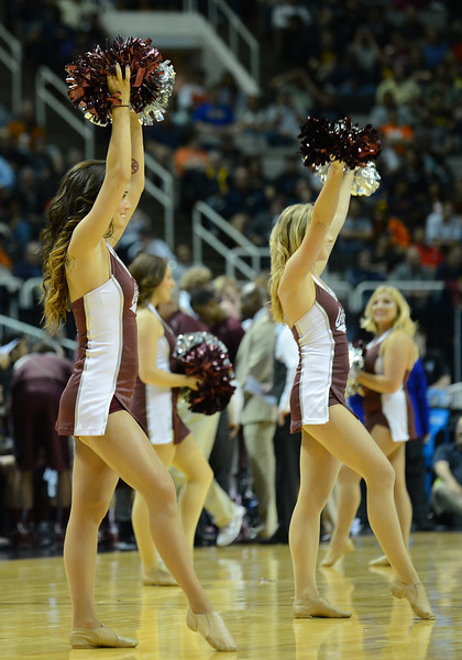 March 21, 2013: The Montana Grizzlies cheerleaders perform in a timeout during a game between the Syracuse Orangemen and the Montana Grizzlies in the second round of the NCAA Division I Men's Basketball Championship at HP Pavilion in San Jose, California.