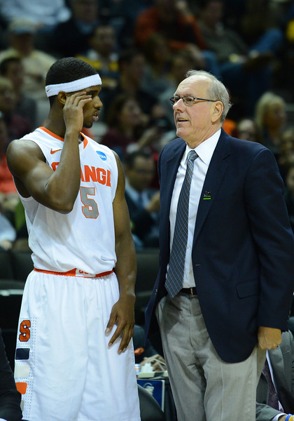 March 21, 2013: Syracuse Orange head coach Jim Boeheim talks to Syracuse Orange forward C.J. Fair (5) during a game between the Syracuse Orangemen and the Montana Grizzlies in the second round of the NCAA Division I Men's Basketball Championship at HP Pavilion in San Jose, California.