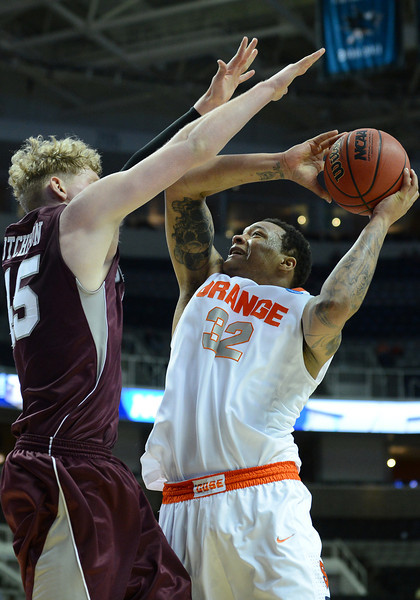 March 21, 2013: Syracuse Orange forward DaJuan Coleman (32) attempts a shot during a game between the Syracuse Orangemen and the Montana Grizzlies in the second round of the NCAA Division I Men's Basketball Championship at HP Pavilion in San Jose, California.